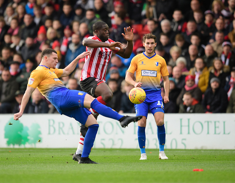 Lincoln City's John Akinde vies for possession with Mansfield Town's Matt Preston<br /> <br /> Photographer Chris Vaughan/CameraSport<br /> <br /> The EFL Sky Bet League Two - Lincoln City v Mansfield Town - Saturday 24th November 2018 - Sincil Bank - Lincoln<br /> <br /> World Copyright © 2018 CameraSport. All rights reserved. 43 Linden Ave. Countesthorpe. Leicester. England. LE8 5PG - Tel: +44 (0) 116 277 4147 - admin@camerasport.com - www.camerasport.com