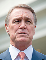 United States Senator David Perdue (Republican of Georgia) speaks to reporters outside the White House after meeting US President Donald J. Trump to discuss his proposed legislation to enact a skills-based immigration system called the Reforming American Immigration for a Strong Economy (RAISE) Act that they claim would also result in a lower level of immigration.<br /> Credit: Ron Sachs / CNP / MediaPunch