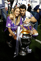 Calcio, Champions League: finale Juventus vs Real Madrid. Cardiff, Millennium Stadium, 3 giugno 2017.<br /> Real Madrid's Alvaro Morata, right, and his girlfriend Alice Campello pose with the trophy at the end of the Champions League final match between Juventus and Real Madrid at Cardiff's Millennium Stadium, Wales, June 3, 2017. Real Madrid won 4-1.<br /> UPDATE IMAGES PRESS/Isabella Bonotto
