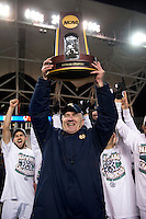 Notre Dame head coach Bobby Clark raises the trophy after the NCAA Men's College Cup final at PPL Park in Chester, PA.  Notre Dame defeated Maryland, 2-1.
