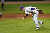 LSU Tigers third baseman Tyler Hanover #11 fields a bunt to make an outstanding defensive play against the Mississippi State Bulldogs at the NCAA baseball game on March 16, 2012 at Alex Box Stadium in Baton Rouge, Louisiana. LSU defeated Mississippi State 3-2 in 10 innings. (Andrew Woolley / Four Seam Images).