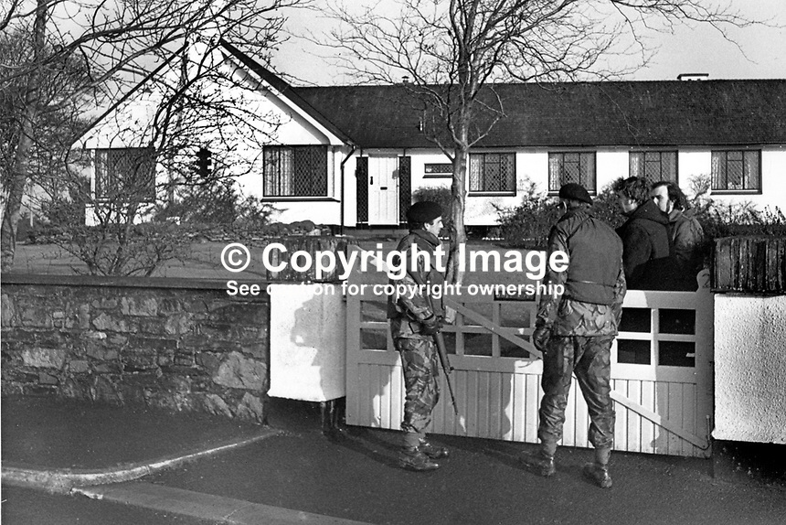 Soldiers posted outside the home in Talbot Park, Londonderry, N Ireland, of Jeffrey Agate who was murdered by Provisional IRA gunmen when he returned from work on 2nd February 1977. Mr Agate, an Englishman, was the managing director of the Du Pont plant at nearby Maydown. 197702020016..Copyright Image from Victor Patterson, 54 Dorchester Park, Belfast, United Kingdom, UK...For my Terms and Conditions of Use go to http://www.victorpatterson.com/Victor_Patterson/Terms_%26_Conditions.html
