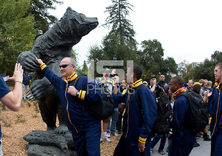 California head coach Jeff Tedford touches the bear statue before walking to the Memorial Stadium with his players before the game against Nevada at Memorial Stadium in Berkeley, California on September 1st, 2012.  Nevada Wolf Pack defeated California, 31-24.