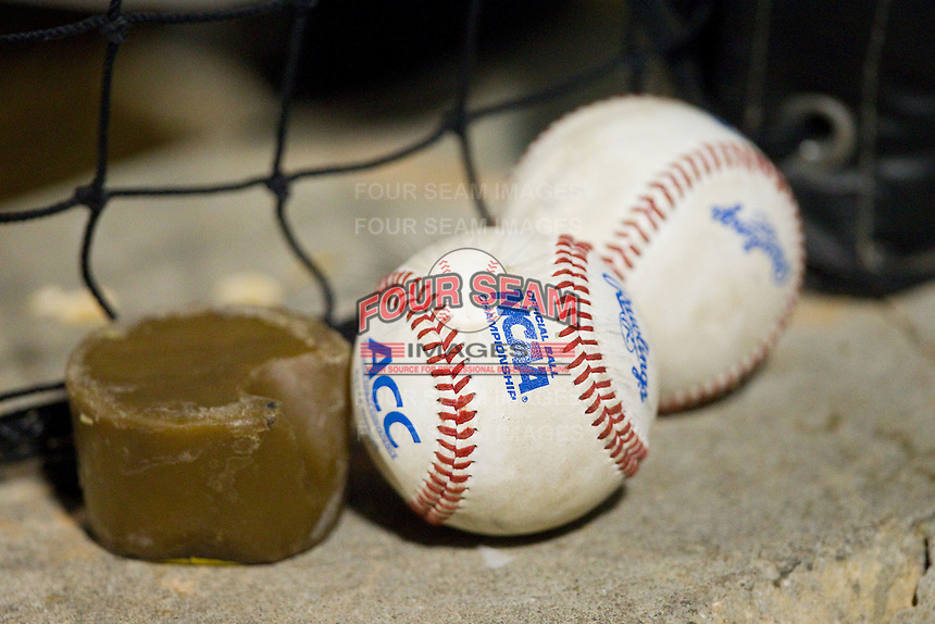 A couple of ACC baseballs sit in the Wake Forest Demon Deacons dugout during the game against the High Point Panthers at Wake Forest Baseball Park on April 2, 2014 in Winston-Salem, North Carolina.  The Demon Deacons defeated the Panthers 10-6.  (Brian Westerholt/Four Seam Images)