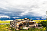 Stormy day at the Shane Cabin of the movie &quot;Shane&quot; fame.  The Grand Tetons of Jackson Hole are the mountains in the distance.  Grand Teton National Park<br />