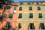 Faded Italian colors can still brighten the scene of these old apartments in Vernazza, in the Cinque Terre, Italy.
