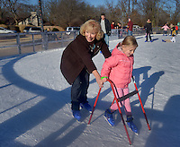 STAFF PHOTO BEN GOFF  @NWABenGoff -- 12/28/14 Heidi DeGraf helps her granddaughter Emma DeGraf, 5, learn how to skate at The Rink at Lawrence Plaza in Bentonville on Sunday Dec. 28, 2014. The family from Glen Ellyn, Ill. where in town visiting family for the holidays.
