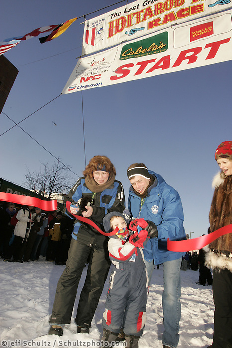 March 3, 2007   The mayor's of Wasilla and Anchorage (and the Mayor's son) cut the ceremonial ribbon during the Iditarod ceremonial start day in Anchorage