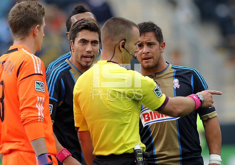CHESTER, PA - OCTOBER 27, 2012:  Michael Farfan (21) and Danny Cruz (44) of the Philadelphia Union argue a penalty kick decision by referee Chris Penso for the New York Red Bulls during an MLS match at PPL Park in Chester, PA. on October 27. Red Bulls won 3-0.