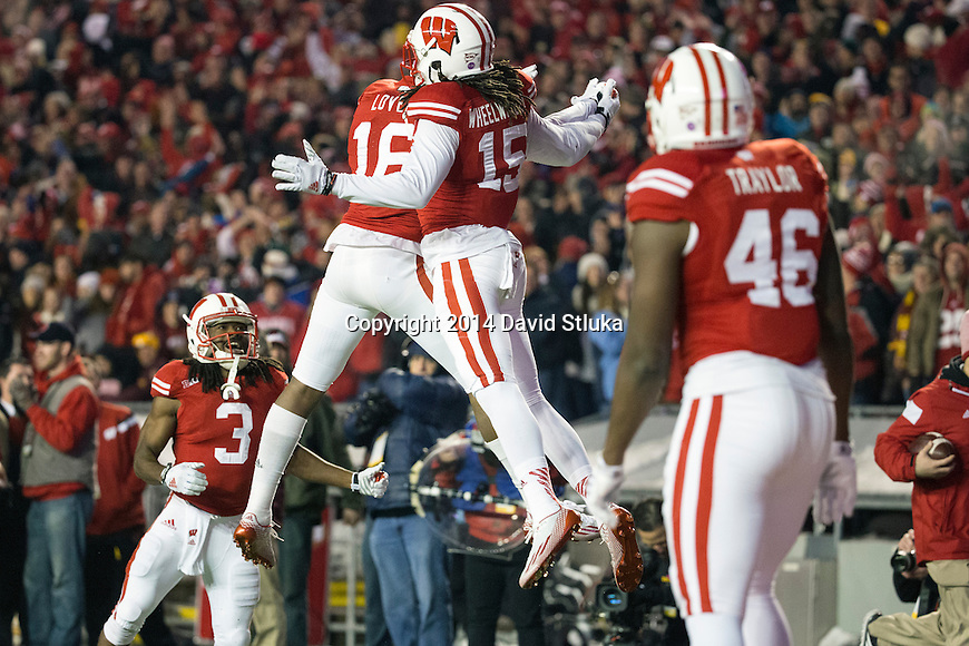 Wisconsin Badgers wide receiver Robert Wheelwright (15) celebrates his first career touchdown during an NCAA Big Ten Conference football game against the Minnesota Golden Gophers Saturday, November 29, 2014, in Madison, Wis. The Badgers won 34-24. (Photo by David Stluka)