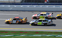 Oct 3, 2008; Talladega, AL, USA; NASCAR Sprint Cup Series driver Kyle Busch (18) leads Greg Biffle (16) and Jimmie Johnson (48) during practice for the Amp Energy 500 at the Talladega Superspeedway. Mandatory Credit: Mark J. Rebilas-