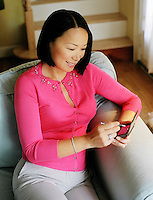 Asian woman with PDA, blackberry