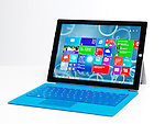 Microsoft Surface Pro 3 tablet computer with a blue keyboard isolated on white background
