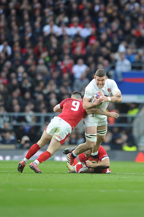 Mark Wilson of England is tackled by Tomos Williams of Wales during the Guinness Six Nations match between England and Wales at Twickenham Stadium on Saturday 7th March 2020 (Photo by Rob Munro/Stewart Communications)
