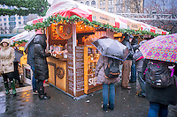 """Shoppers browse the Union Square Holiday Market in New York on a rainy Saturday, December 6, 2014. 150 vendors, including a """"Made in Brooklyn"""" section, sell their holiday wares at the market, now in it's 21st year. The market will remain open daily, closing on December 24.  (© Richard B. Levine)"""