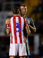 Lincoln City's Matt Rhead with Stoke City's Stephen Ward at the end of the game<br /> <br /> Photographer Chris Vaughan/CameraSport<br /> <br /> Football Pre-Season Friendly - Lincoln City v Stoke City - Wednesday July 24th 2019 - Sincil Bank - Lincoln<br /> <br /> World Copyright © 2019 CameraSport. All rights reserved. 43 Linden Ave. Countesthorpe. Leicester. England. LE8 5PG - Tel: +44 (0) 116 277 4147 - admin@camerasport.com - www.camerasport.com