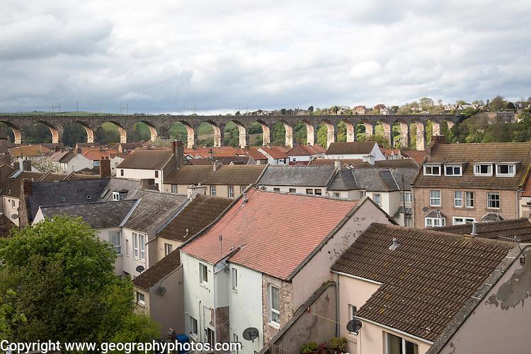 View of railway viaduct over rooftops, Berwick-upon-Tweed, Northumberland, England, UK