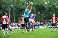 ROLDE - Voetbal, FC Groningen - FC Emmen, voorbereiding seizoen 2019-2020, 16-07-2019,  FC Emmen doelman Dennis Telgenkamp  redt in duel met FC Groningen speler Bart van Hintum