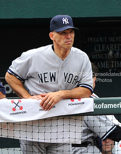 New York Yankees manager Joe Girardi (28) watches his team bat in the first inning against the Baltimore Orioles at Oriole Park at Camden Yards in Baltimore, Maryland in the first game of a doubleheader on Sunday, August 28, 2011.  .Credit: Ron Sachs / CNP.(RESTRICTION: NO New York or New Jersey Newspapers or newspapers within a 75 mile radius of New York City)