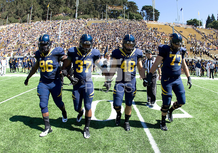 California starting captains' Kendrick Payne, Robert Mullins, Eric Stevens and Tyler Rigsbee walk on the field for coin toss before the game against Southern Utah at Memorial Stadium in Berkeley, California on September 8th, 2012.   California Golden Bears defeated Southern Utah, 50-31.