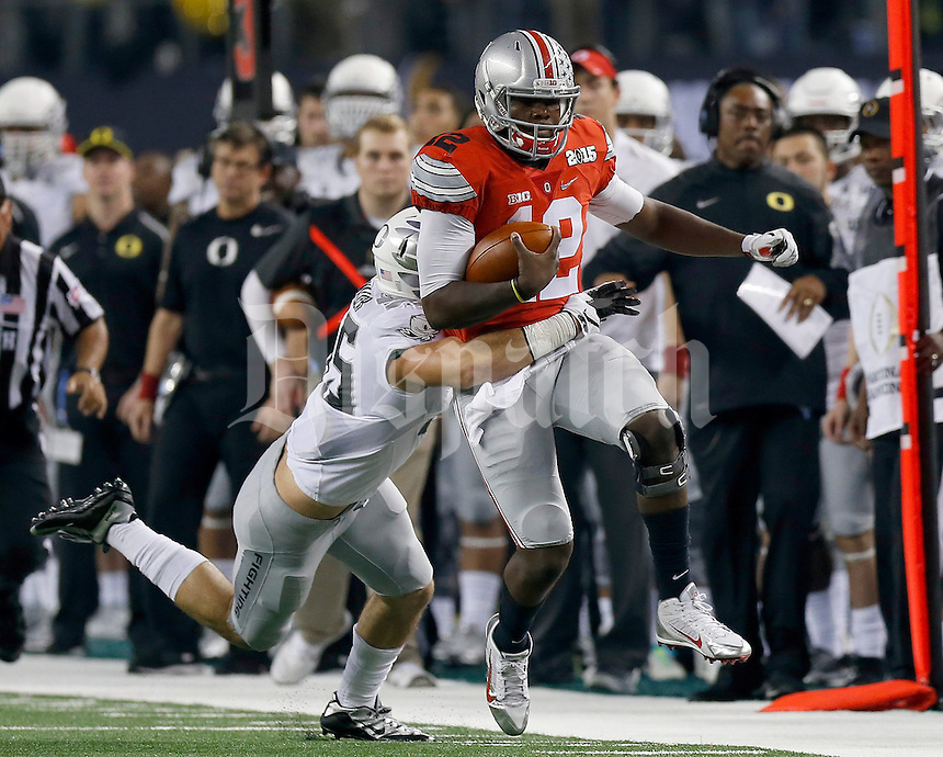 Ohio State Buckeyes quarterback Cardale Jones (12) during the second quarter the College Football Playoff National Championship at AT&T Stadium in Arlington, TX on Monday, January 12, 2015. (Columbus Dispatch photo by Jonathan Quilter)