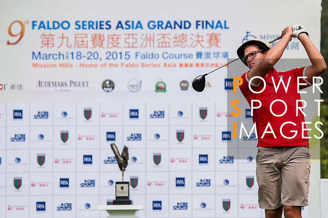 Oscar Cadenhead of New Zealand tees off at tee one during the 9th Faldo Series Asia Grand Final 2014 golf tournament on March 18, 2015 at Mission Hills Golf Club in Shenzhen, China. Photo by Xaume Olleros / Power Sport Images