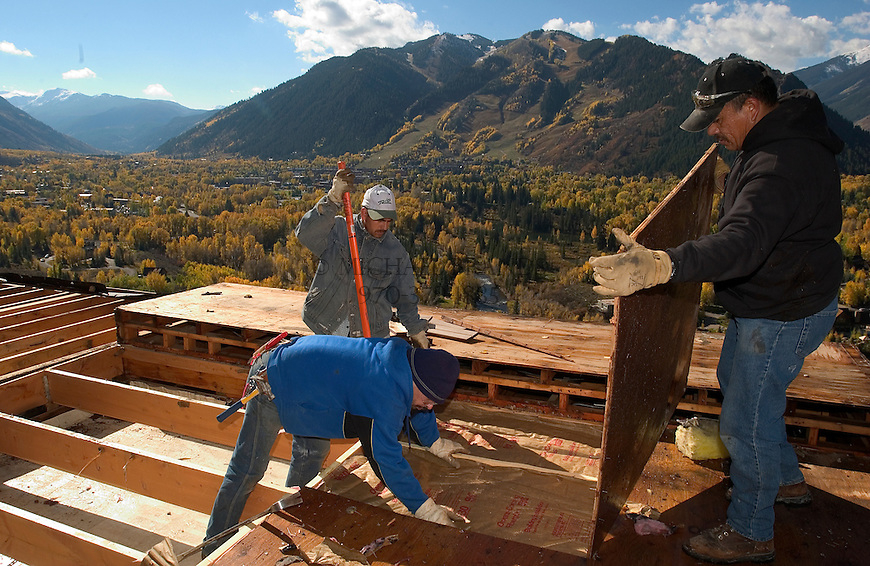 Construction of a home on Red Mountain in Aspen, Colorado. Aspen Mountain ski area in the background. © Michael Brands. 970-379-1885.