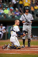 Montgomery Biscuits catcher Justin O'Conner (5) throws to first on a pickoff attempt as Zach Shank (21) looks on during a game against the Jackson Generals on April 29, 2015 at Riverwalk Stadium in Montgomery, Alabama.  Jackson defeated Montgomery 4-3.  (Mike Janes/Four Seam Images)