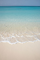 Anguilla, Caribbean - Calm, turquoise water lapps at beach of Rendezvous bay.
