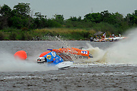 Frame 1: Megan Becan, (#77) rolls over in turn 1 midway through the final heat. She was no injured in the accident. (SST-45 class)