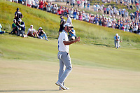 Dustin Johnson (USA) reacts to making a birdie putt on the 18th hole during the 118th U.S. Open Championship at Shinnecock Hills Golf Club in Southampton, NY, USA. 17th June 2018.<br /> Picture: Golffile | Brian Spurlock<br /> <br /> <br /> All photo usage must carry mandatory copyright credit (&copy; Golffile | Brian Spurlock)