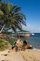 Seychelles, Island Praslin, Anse Bateau: Hotel Coco de Mer - woman, beach, jetty