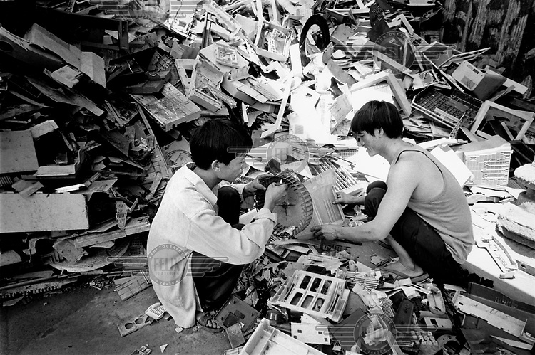 Each plastic part is sorted by heating it with a cigarette lighter. From the fumes workers can tell exactly what kind of plastic they're holding. Every year Guiyu takes in more than a million tons of computer waste, imported from all over the world. About 40,000 local farmers and 100,000 migrant workers make their living from the e-waste, which contains toxic ingredients such as lead, beryllium and mercury. The workers risk catching respiratory and skin diseases, eye infections and even cancer..