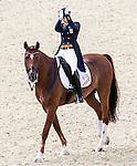 Engeland, London, 9 augustus 2012.Olympische Spelen London.PaardenSport.Adelinde Cornelissen heeft Nederland een zilveren medaille bezorgd. De 33-jarige amazone paradeerde met haar paard Parzival op prachtige wijze door de olympische dressuurring.
