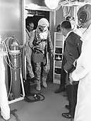 "Cape Canaveral, FL - (FILE) -- Astronaut Alan B. Shepard, Jr., makes his way from the elevator to the cleanroom atop the service tower on Friday, May 5, 1961 where he'll be inserted into his Mercury space capsule nicknamed ""Freedom 7.""  Astronaut Virgil I. ""Gus"" Grissom is there to greet him..Credit: NASA via CNP."