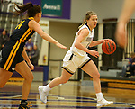 SIOUX FALLS, SD - DECEMBER 7: Hannah Jones #5 from the University of Sioux Falls pushes the ball past Lexi Lee #14 from Concordia St. Paul during their game Friday night at the Stewart Center in Sioux Falls, SD. (Photo by Dave Eggen/Inertia)