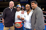 Manhattan, NY, 06.20.07: (l-r) Promoter Lou DiBella, Paulie Malignaggi , Buddy McGirt Sr. at the official presentation of the  IBF Junior Welterweight Championship belt  a few days after his fight against Lovemore N'Dou at the Mohegan Sun Casino, June 16th, 2007. Malignaggi won the belt from N'Dou by unanimous decision.. Photo by Thierry Gourjon.