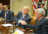 "United States President Donald Trump shakes hands with Robert J. Hugin, Executive Chairman, Celgene Corporation, as he meets with representatives from PhRMA, the Pharmaceutical Research and Manufacturers of America in the in the Oval Office Roosevelt Room of the White House in Washington, DC on Tuesday, January 31, 2017.  According to its website PhRMA ""represents the country's leading biopharmaceutical researchers and biotechnology companies."" Kenneth C. Frazier, Chairman and CEO of Merck & Co looks on from left.<br /> Credit: Ron Sachs / Pool via CNP"