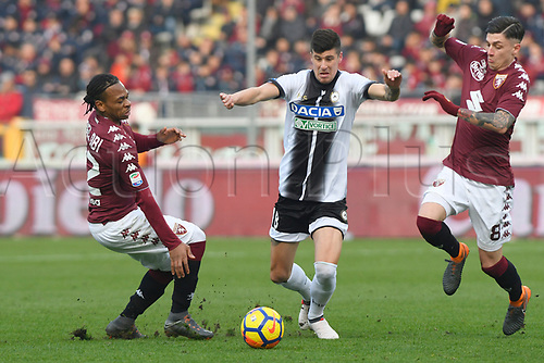 11th February 2018, Stadio Olimpico di Torino, Turin, Italy; Serie A football, Torino versus Udinese; Stipe Perica gets between Joel Obi and Daniele Baselli