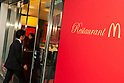 A sign of the ''Restaurant M'' event on display at the entrance of the McDonald's restaurant chain in the posh Roppongi Hills area on July 27, 2015, Tokyo, Japan. 20 chosen diners (from 8,300 applications) ate a special multi-course dinner created by the celebrity chef using ingredients from the restaurant chain's regular menu. The special one-night only event was organized to celebrate the launch of its new summer menu ''Fresh Mac,'' which features fresh vegetables. The five-course meal served on a white tablecloth with plates and proper cutlery included a Vichyssoise en Pommes de terre de McDonald, Mousse au Poivron Rouge, Salade en Gelee aux Legumes de McDonald, Cinq Pinchos des McDonald Patties avec leur Sauces, a choice of main dish including the Fresh Mac Bacon Lettuce Burger, and a McFlurry Mixed Berry Oreo dessert with a Premium Roast Coffee. (Photo by Rodrigo Reyes Marin/AFLO)