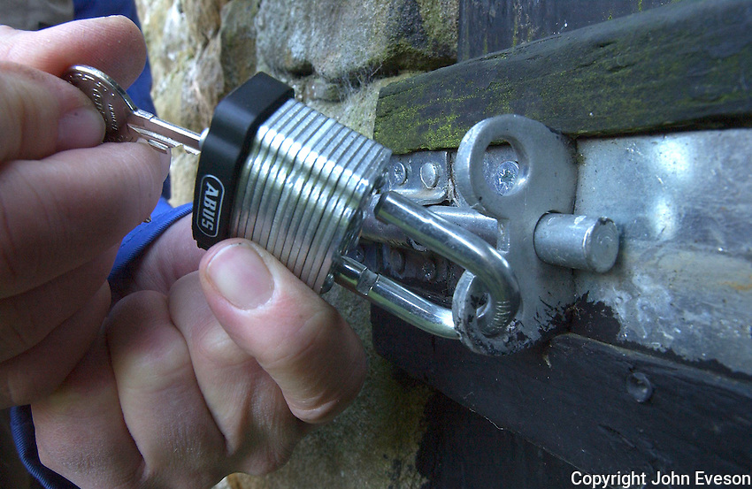 Locking a security padlock.
