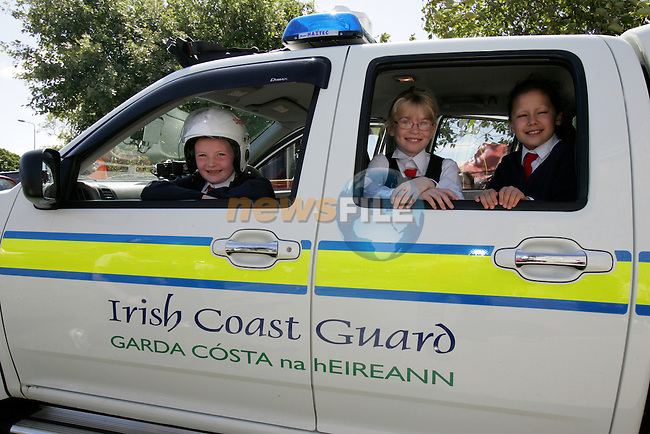 Students Catriona McDonagh, Sabhaoine O'Sullivan, Ciara Leboy   from Donacarney Girls School..Photo: Newsfile/Fran Caffrey..The summer is here and the Drogheda Coast Guard Unit are back visiting the local Primary Schools for their Annual Water Safety Talk..This has been a very successful campaign over the last four years; we have educated thousands of children in all aspects of Water Safety form the Louth and Meath Areas..We introduce the children to the basic dangers that they are likely to encounter when visiting the seaside, lakes and rivers. We also teach them the Safe Swimming Guide..We demonstrate the wearing of Lifejackets and Buoyancy Aids, how to get help if the find someone in trouble in the water, at the seaside or near cliffs..We also demonstrate the equipment that the Coast Guard wear and use in different areas of operations..The children are then brought into the schoolyard where we show them one of our Coast Guard Boats and all Life Saving Equipment on board..Last year we visited thirty schools reaching approx. three thousand children..We wish everyone a warm and happy summer..Enjoy our local waterways and coast, always read signs, stay alert and beware of any dangers..If you see any one in difficulty in our local Rivers, Lakes or along our Coast, Call 112 or 999 and ask for the Coast Guard...Dermot Mc Connoran .Area Officer .Drogheda Coast Guard...
