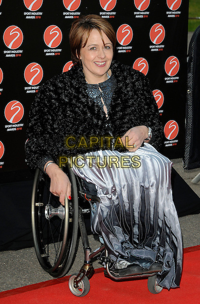 BARONESS TANNI GREY-THOMPSON .At the Sport Industry Awards, Battersea Evolution, London, England, UK, .May 13th 2010..arrivals full length wheelchair disabled black jacket   lace silver grey gray dress .CAP/CAN.©Can Nguyen/Capital Pictures.