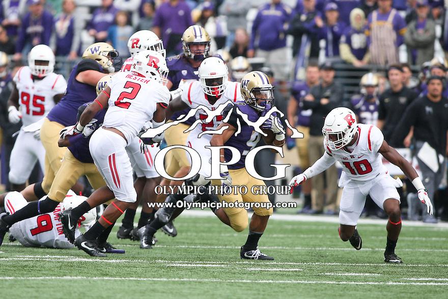 03 September 2016:  Washington's #9 Myles Gaskin breaks up field for extra yardage against Rutgers.  Washington defeated Rutgers 48-13 at the University of Washington in Seattle, WA.
