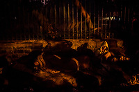 OLD DELHI, INDIA, JANUARY 12, 2016: Men covered under rented blankets sit against a wall during the early morning, adjacent to a sleep market on January 12, 2016 in Old Delhi, India. <br /> Daniel Berehulak for The New York Times