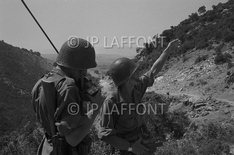 """Ecole Militaire d'Infanterie de Cherchell, Algérie, Sept 1960. EOR (Eleves Officiers de Reserves) The futur infantery officers during their long training walks. They must use to the climate and to the """"djebels"""" the hard dry lands of most Algéria. The futur infantery officers during their long training walks of 40 to 50kms with 40lb equipment and hard hat plus arms and amunitions."""