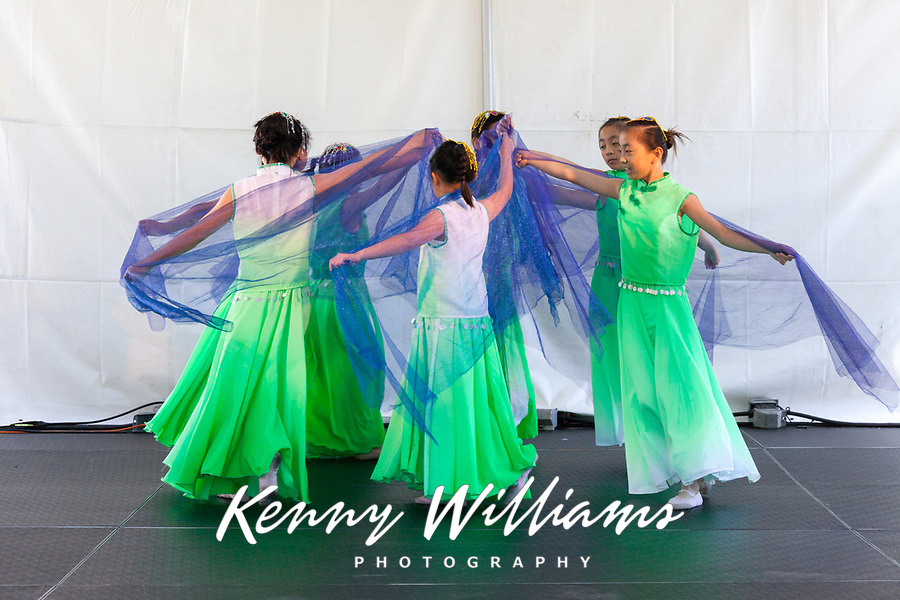 Girls wearing green dresses dancing Chinese Blue Vail Dance, Northwest Folklife Festival 2016, Seattle Center, Washington, USA.