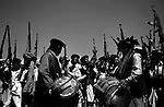 barwaiz raghzai hills, waziristan, april 2004: men celebrate the formation of a tribal laskkar with song and dance.  all of waziristan's tribes participated in the lashkar that was formed to hunt for suspected al qaeda hideouts and their inhabitants.<br />