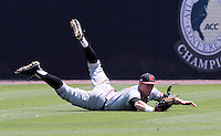 Maryland outfielder Tim Lewis (39) makes a diving catch in the first inning of an NCAA college baseball tournament super regional game against Virginia in Charlottesville, Va., Saturday, June 7, 2014. Maryland defeated Virginia 5-4. (AP Photo/Andrew Shurtleff)