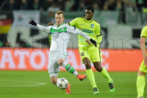 08.03.2016. Wolfsburg, Germany.  Maximilian Arnold midfielder of VfL Wolfsburg is challenged by Neto Renato Cardoso midfielder of KAA Gent during the Champions League Round of 16, second leg match between VfL Wolfsburg and KAA Gent at the Volkswagen Arena in Wolfsburg, Germany.